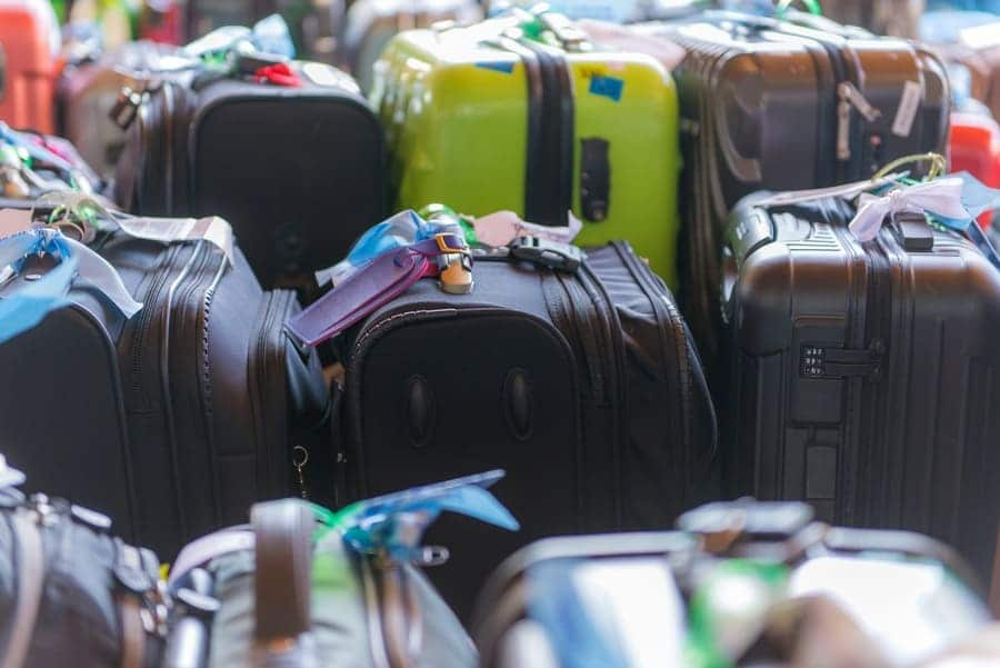 Luggage consisting of large suitcases, rucksacks, and travel bag.