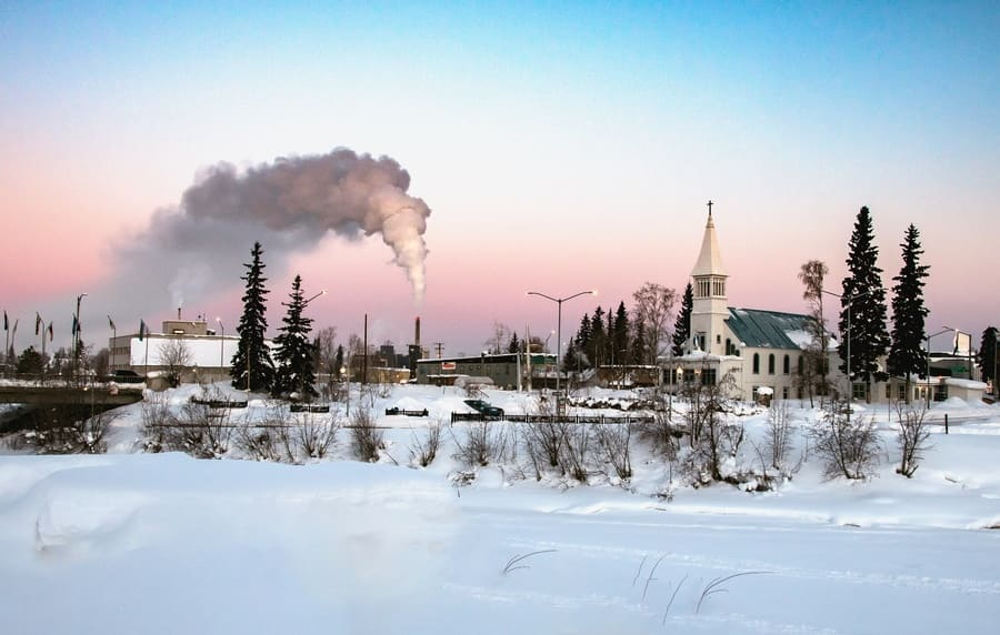view of downtown Fairbanks Alaska across frozen Chena river on a bright winter morning
