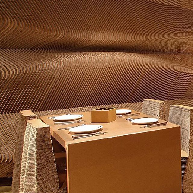 The interior of Cardboard Café. Table and seats.