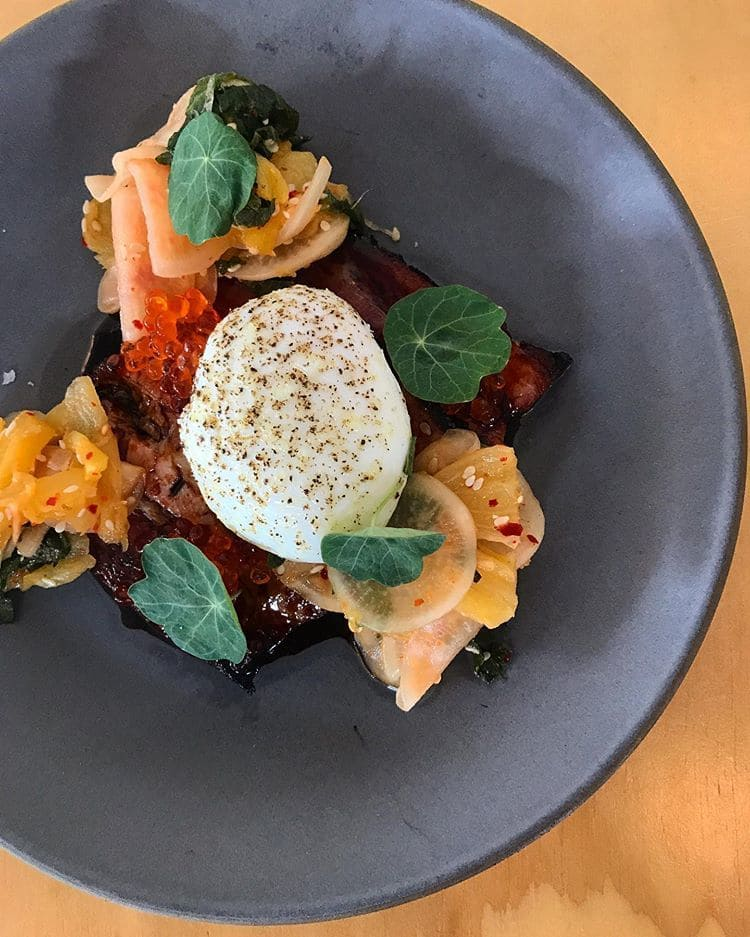 poached egg, galangal soda braised pork belly with turnip and pineapple kimchi, and lime cured trout roe.