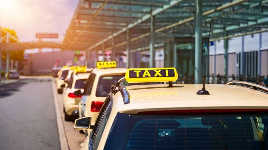 Taxi cabs waiting for passengers.