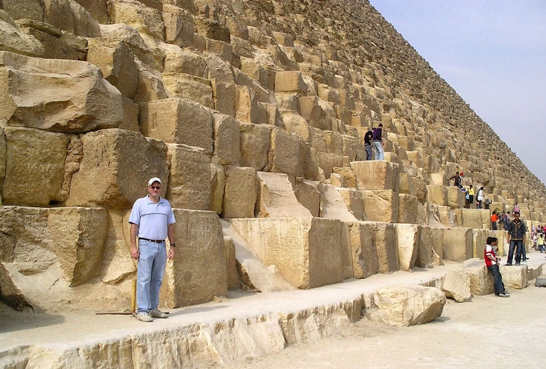 man standing on the pyramids of Giza
