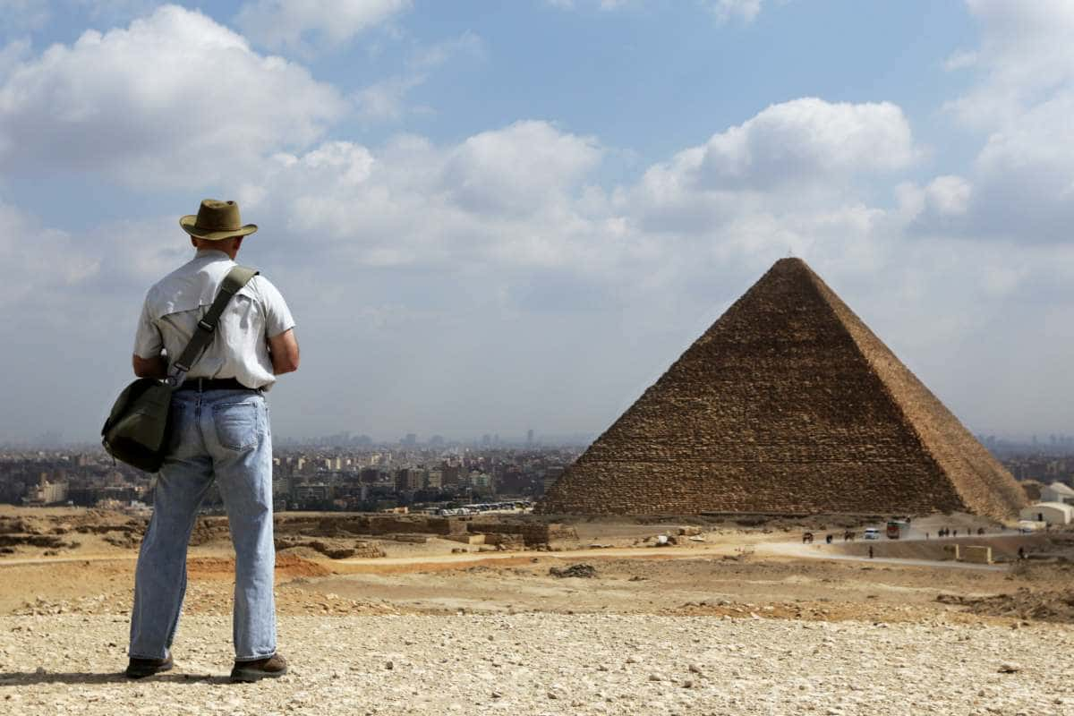 man in front of the Pyramid