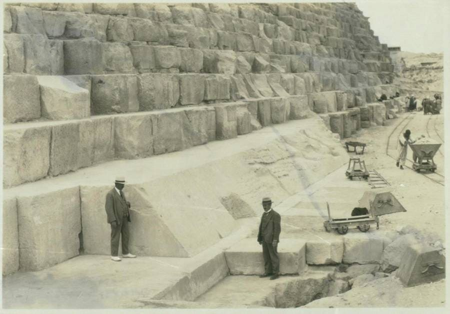 gentlemen in the foreground of the Great Pyramid archeological site
