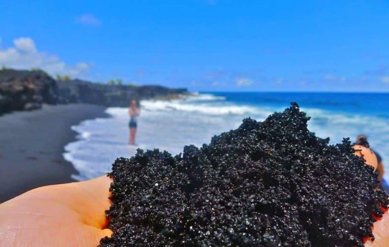 A beach with black sand