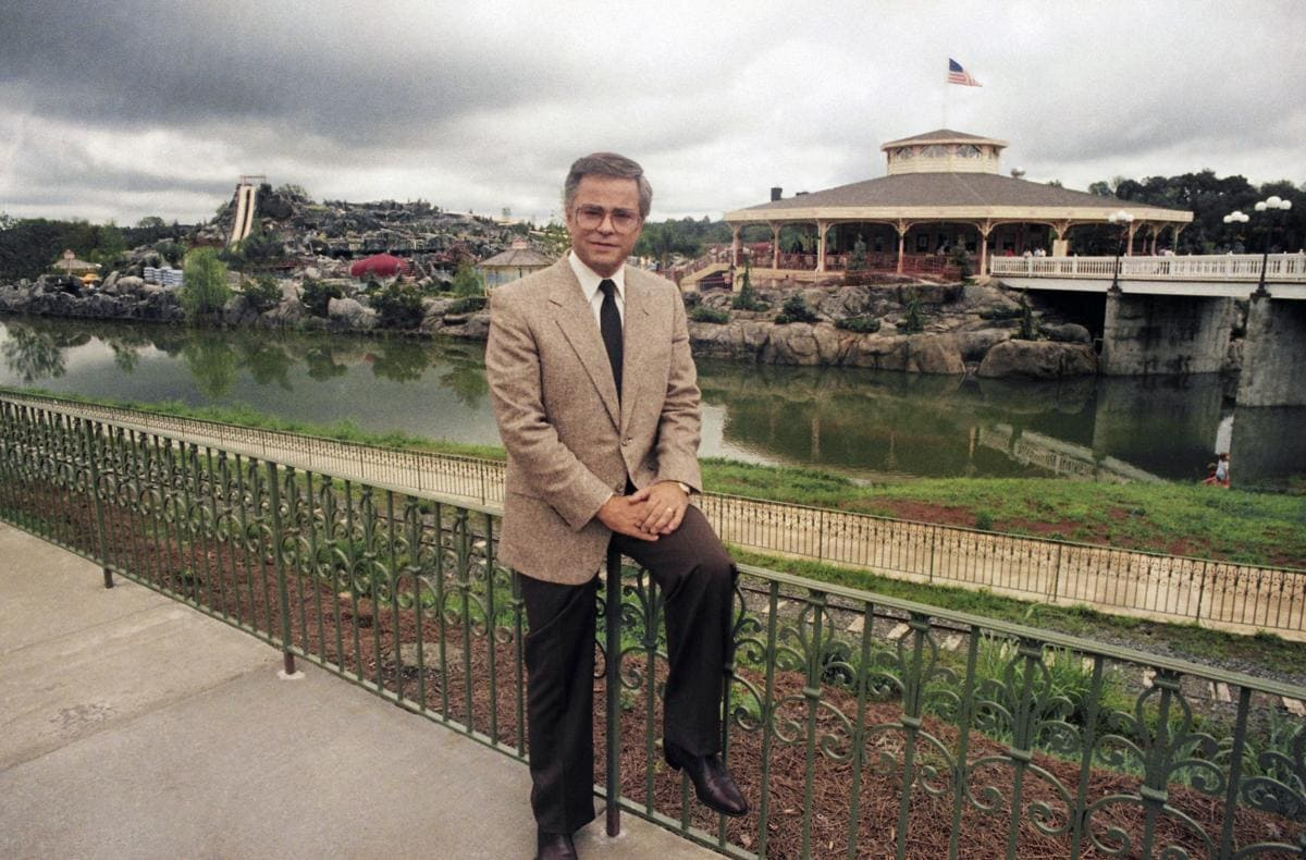 Jim Bakker standing in front of the water theme park he created