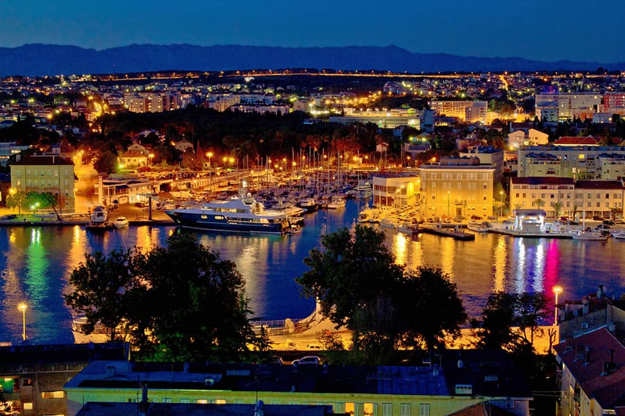 Zadar luxury yacht marina night view, with cityscape, Dalmatia, Croatia
