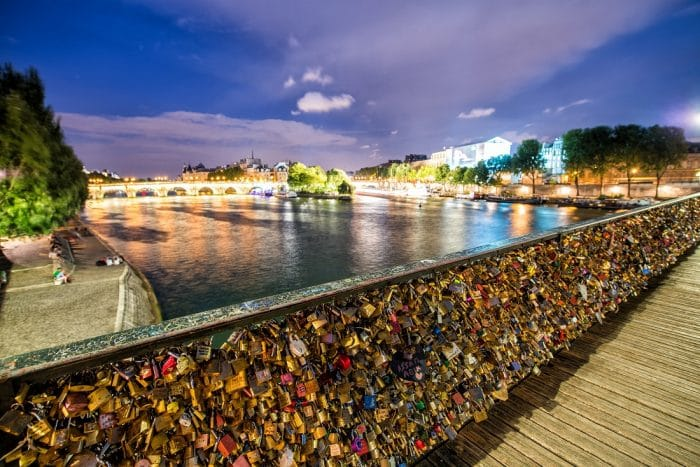 Love padlocks at Pont de l'Archeveche in Paris. The thousands of locks of loving couples symbolize love forever