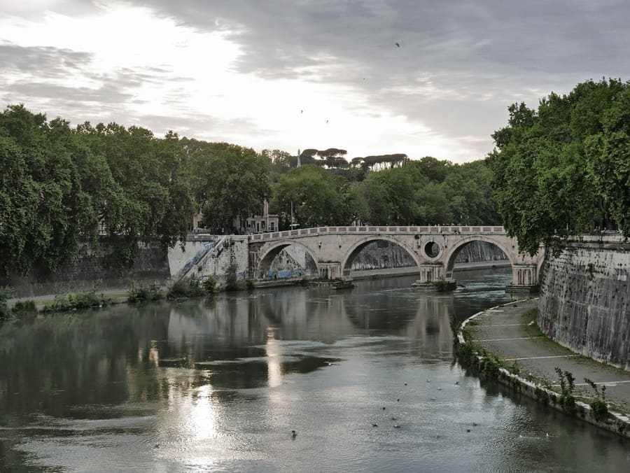 Tiber River and Ponte Sisto bridge at sunset in Rome, Italy