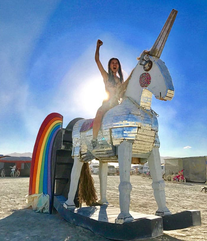 A girl on a unicorn sculpture