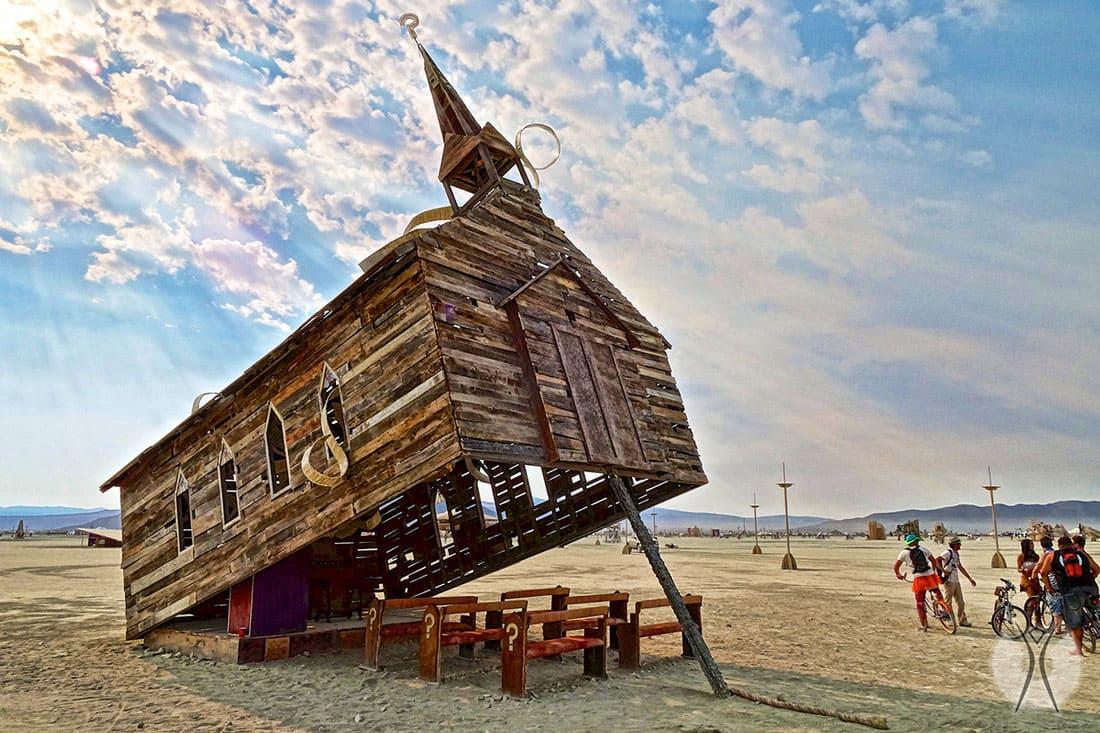 A tilted hut on a beach