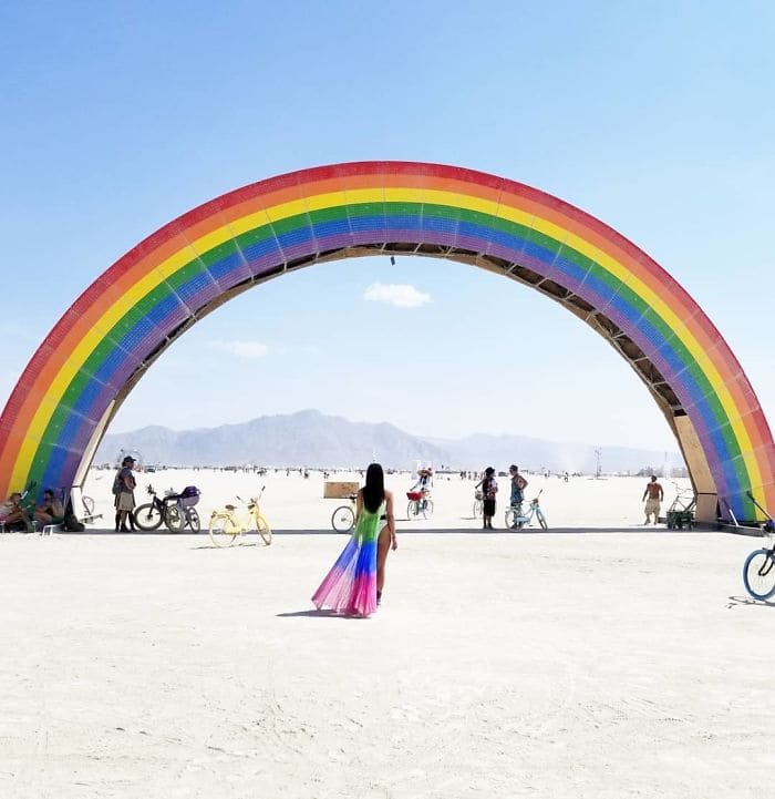 Woman about to walk through a rainbow