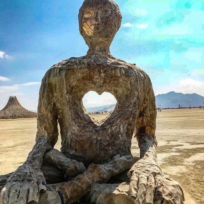 Sculpted man with a heart-shaped hole