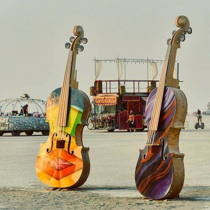 Two beautiful and colorful guitars