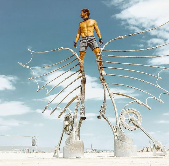 Man standing on sculpted tilts