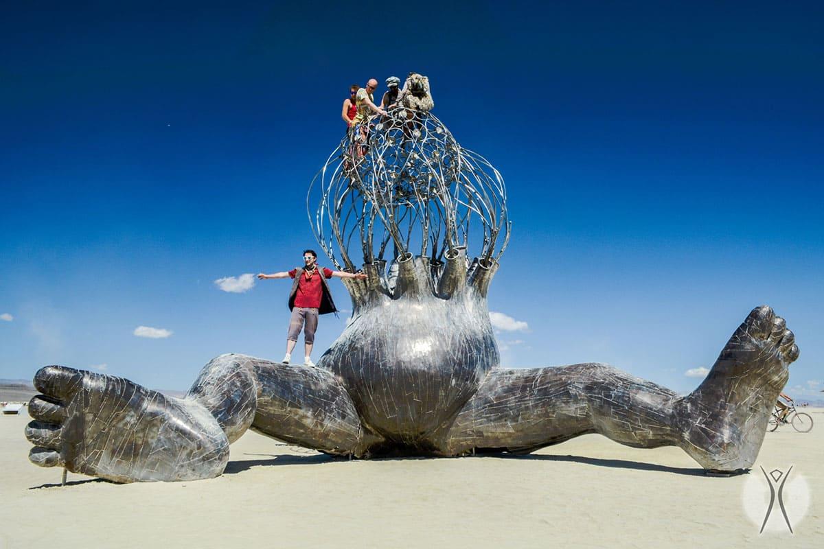 People standing on huge sculpted feet