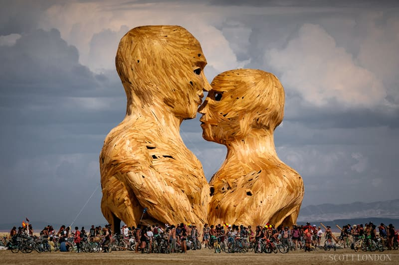 Sculpted couple surrounded by people