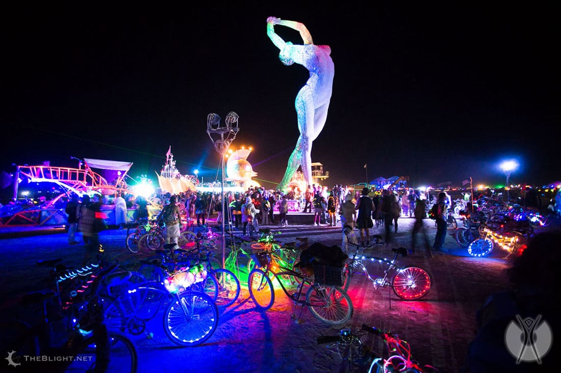 Sculptures with neon lights on a beach