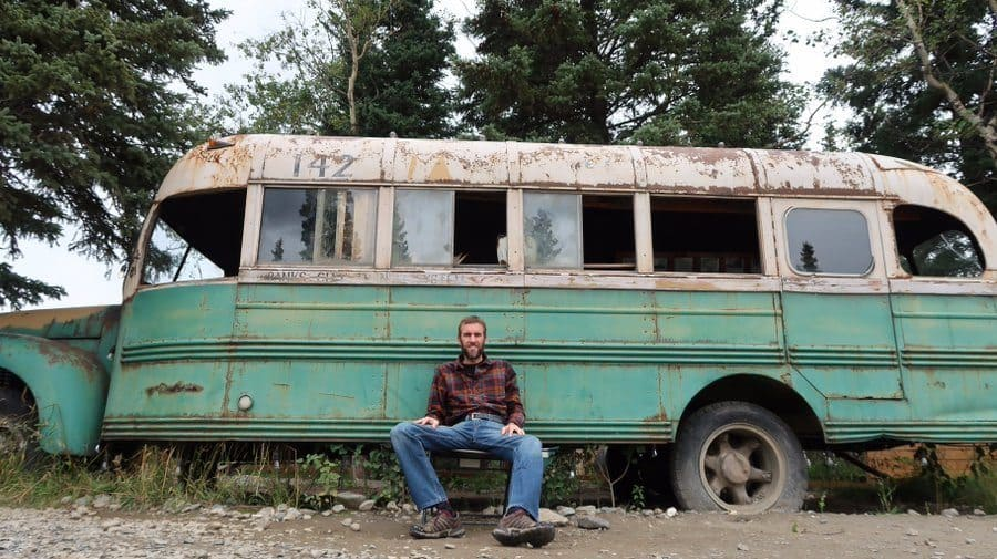 Gabriel Morris posing at Chris McCandless's Bus