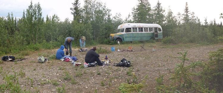 A group of hikers takes a break at Bus 142