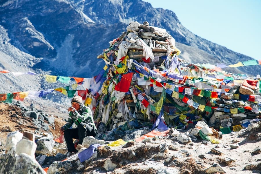 Sherpa is taking a break on the way to Mount Everest base camp.