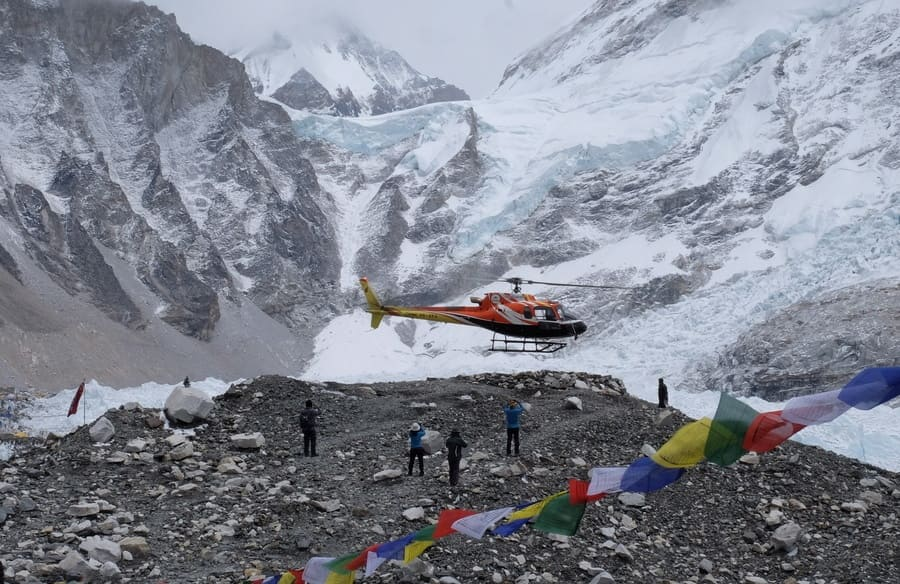Rescue helicopter landing at Everest Base Camp