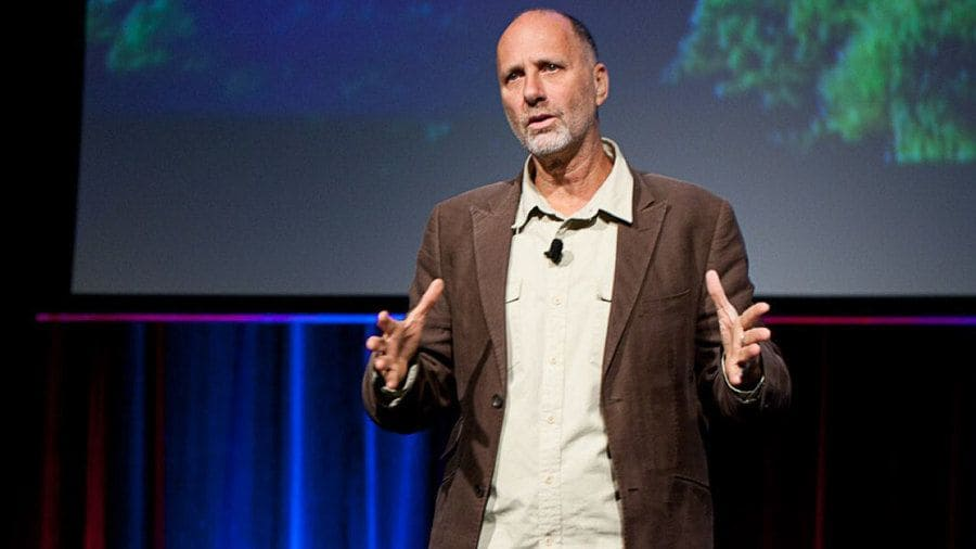 Yossi Ghinsberg speaking in front of a crowd