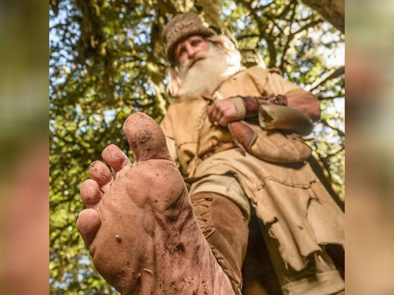 Mick Dodge holding his foot out for the camera