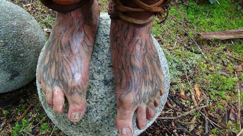 Mick Dodge's feet with tattooed veins.