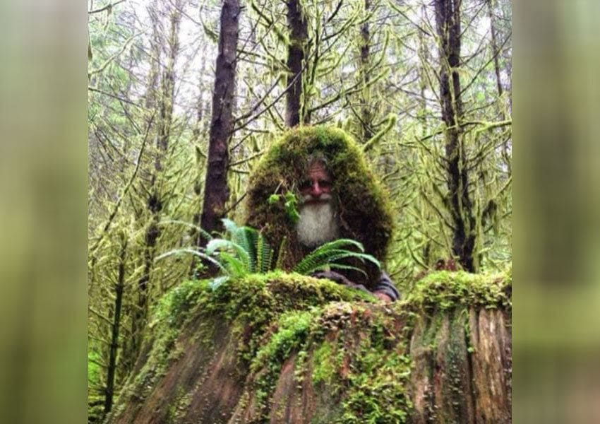 Mick Dodge wearing grass around his head to blend in