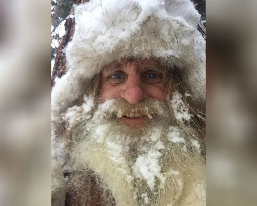 Mick Dodge is covered in snow with a frozen looking beard.