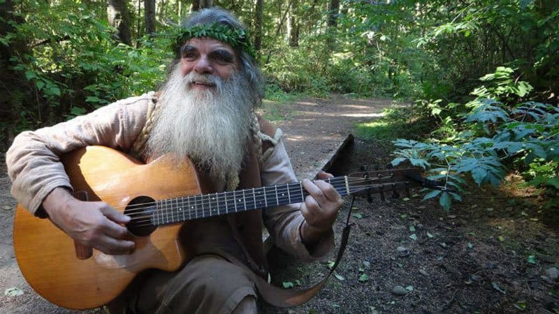A friend of Mick Dodge's playing the guitar