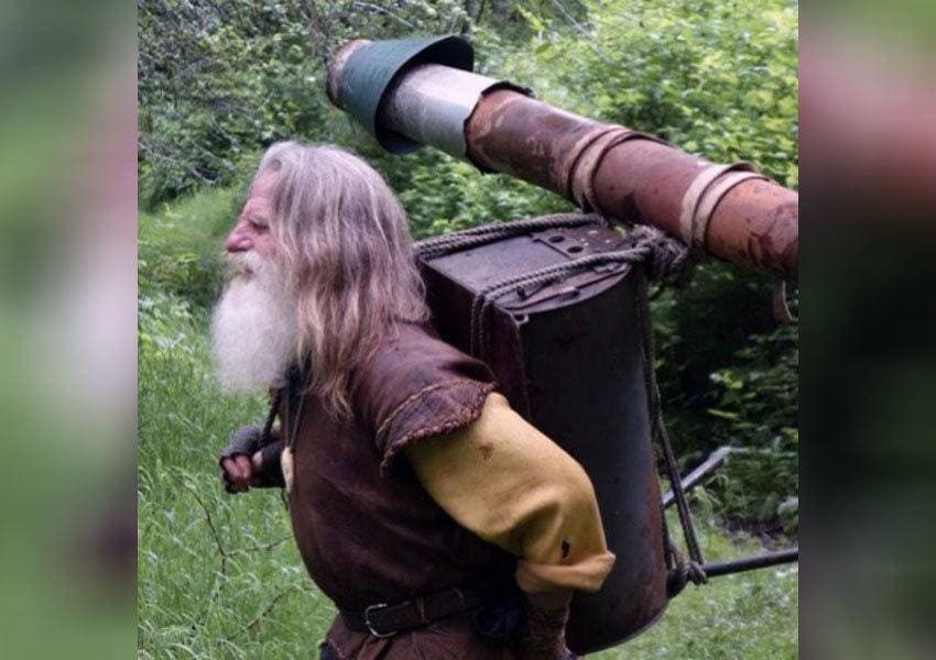 Mick Dodge is holding equipment on his back