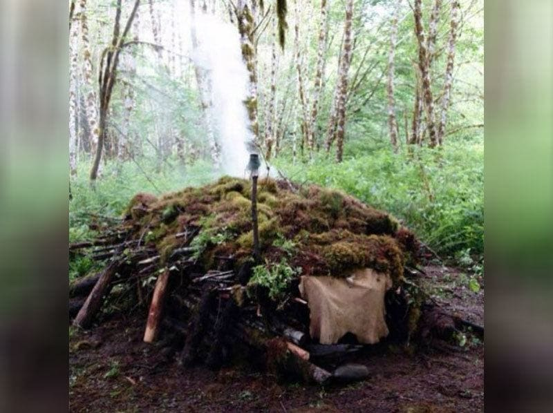 Mick Dodge's make-shift tent with green moss on top