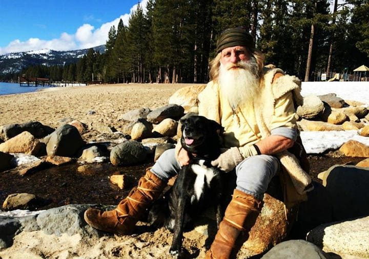 Mick Dodge is with his dog on the lakeside