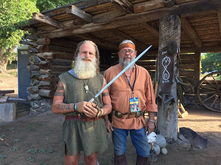 Mick Dodge and a guest are standing at the Earth Gym