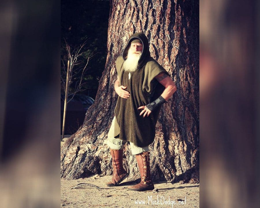 Mick Dodge is standing in front of a tree