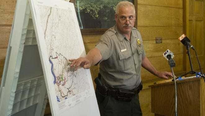 Park Chief Ranger Steve Kloster stands beside a map