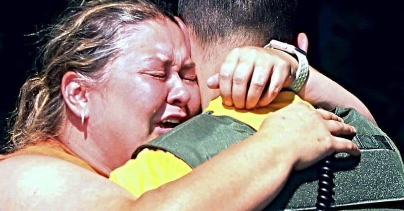 Austin's mom hugs a rescue worker