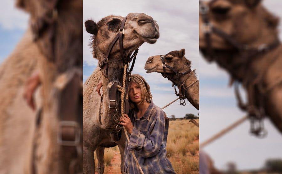 Mia Wasikowska with a camel in Tracks