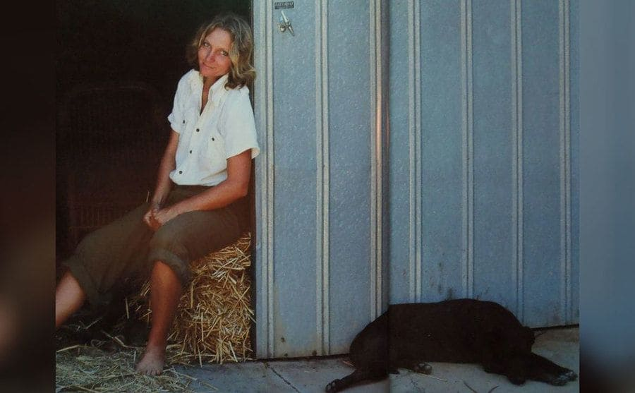 Robyn and Diggity sitting at the entrance of a barn