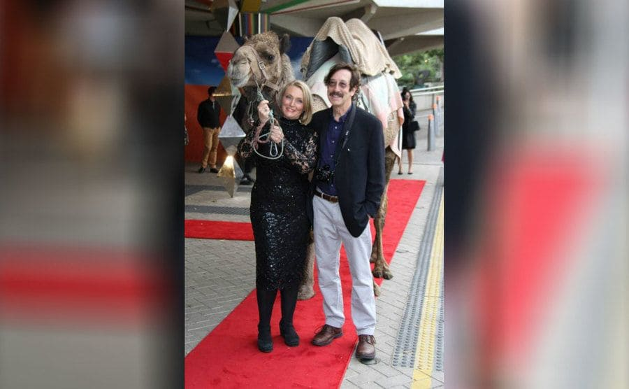 Robyn Davidson and Rick Smolen with a camel at the Tracks premiere