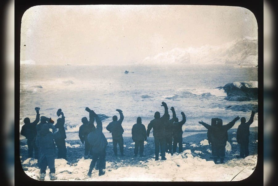 Elephant Island party waving goodbye to sailors on the James Caird