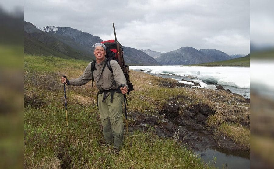 Jim Campbell hiking near snow- and ice-covered river