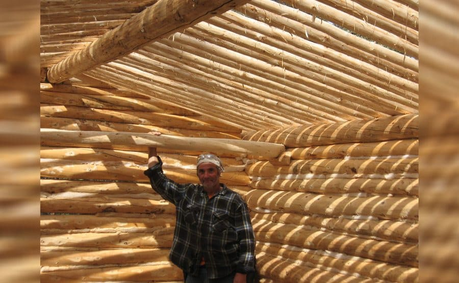 Heimo Korth inside of his log cabin right as it was almost finished