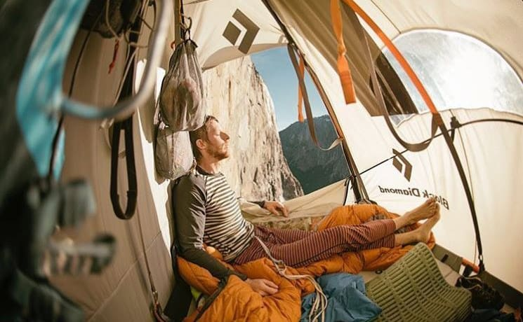 Tommy Caldwell resting in his tent on the side of the wall