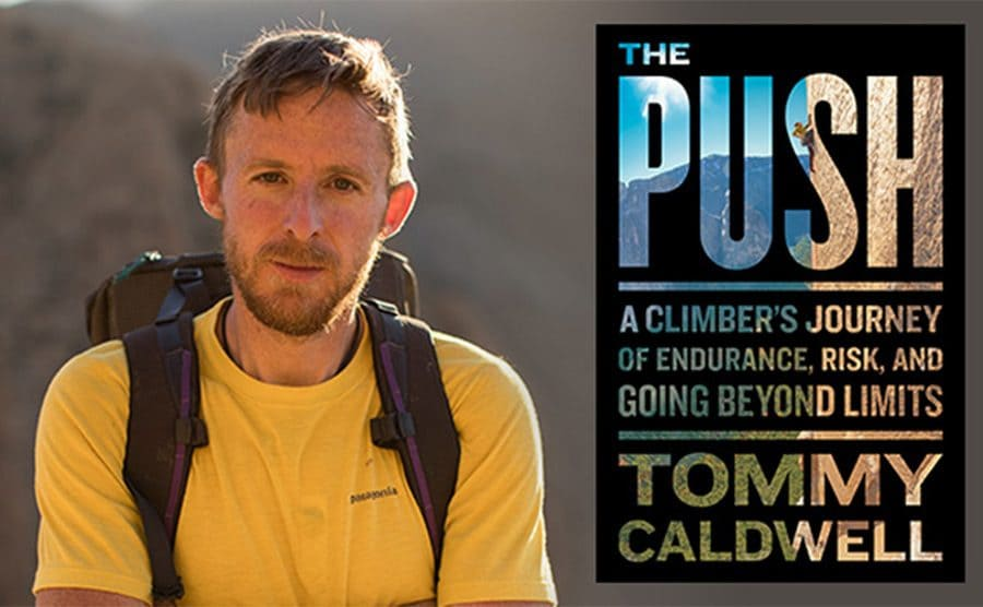 Tommy Caldwell standing next to his book cover for The Push