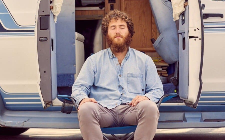 Posner sitting in front of his RV