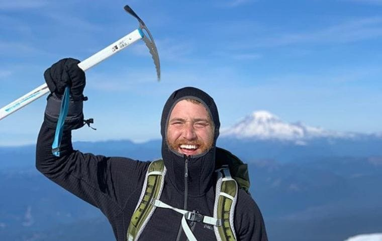 Mike Posner on top of a mountain