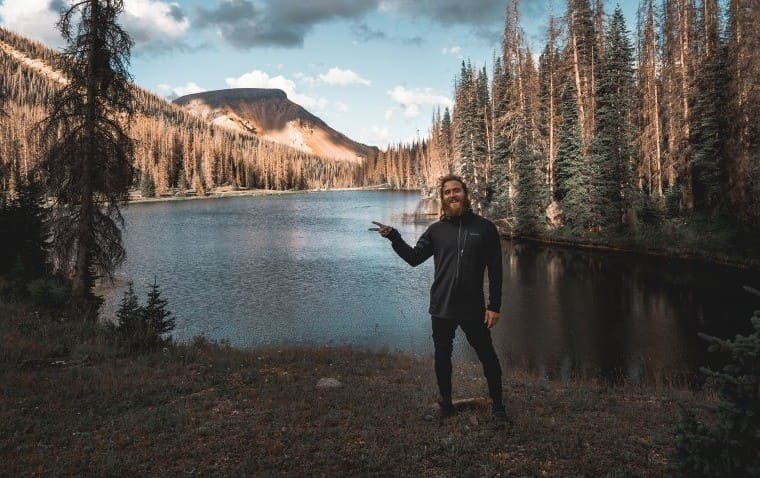 Mike Posner in front of a lake